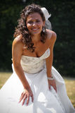 Smiling bride. Bride posing in a natural environmant stock photo