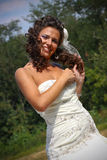 Smiling bride. Bride posing in a natural environmant stock images