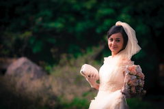 Smiling bride. Smiling happy bride outdor portrait dance wedding dress Royalty Free Stock Photography