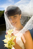 Smiling bride. With bouquet under veil Royalty Free Stock Photos