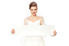 Smiling bride with advertising. Royalty Free Stock Photos