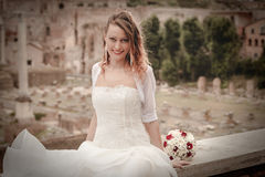 Smiling bride in the ancient city. Rome Italy. Wedding dress. Royalty Free Stock Photo