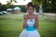 Smiling bride on the background grass Stock Image