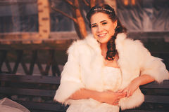 Smiling bride on bench Stock Photography