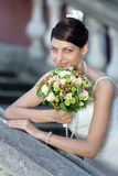 SMiling bride with bouquet. Of colorful flowers royalty free stock photo