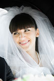 Smiling bride in car Royalty Free Stock Photo