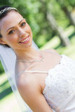 Smiling bride in garden Stock Photo