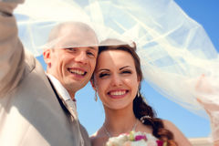 Smiling bride and groom Stock Images