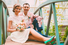 Smiling bride and groom with letters Royalty Free Stock Photo