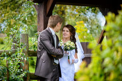Smiling bride and groom outdoor Royalty Free Stock Images