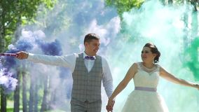 Newlyweds Walking with Colors Smoke Bombs stock footage