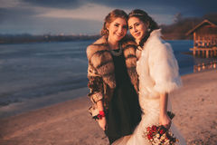 Smiling bride and her sister on the beach Stock Image