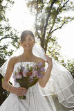 Smiling Bride Holding Bouquet Royalty Free Stock Photo