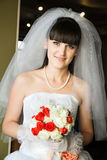 Smiling bride indoors Stock Photo