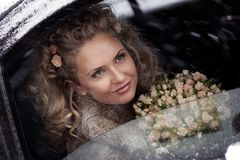 Smiling bride in limo Royalty Free Stock Image