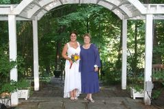 Smiling bride with mother Stock Photo