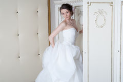 Smiling bride near closet Stock Photos