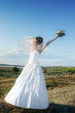 Smiling bride outdoors at dawn Stock Images
