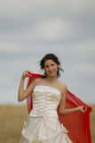 Smiling bride with red cloth Stock Photo