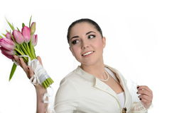 Smiling bride throwing bouquet Stock Photo