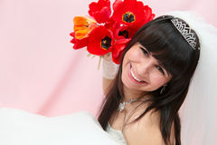 Smiling bride with tulips Royalty Free Stock Images