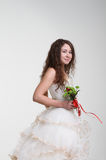 Smiling bride in wedding dress with bouquet Royalty Free Stock Images