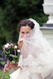 Smiling bride in white with veil Stock Photography