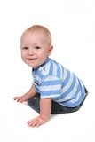 Smiling Bright Baby Boy Sitting and Looking Back Stock Photo