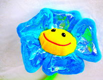 Smiling bright blue yellow toy flower Stock Photo