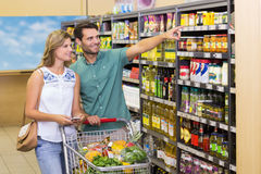 Smiling bright couple buying food products Royalty Free Stock Photo