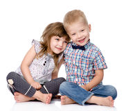 Smiling brother and little sister hugging. isolated Royalty Free Stock Image