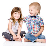 Smiling brother and little sister hugging. isolated on white Royalty Free Stock Photo