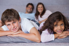 Smiling brother and sister lying on the bed Royalty Free Stock Image