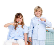 Smiling brother and siter brushing their teeth royalty free stock photography