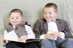 Smiling brothers reading book Stock Photography