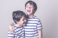 Smiling brothers. With striped shirt Stock Photography