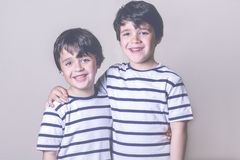 Smiling brothers. With striped shirt Royalty Free Stock Photography