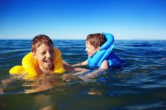 Smiling brothers swimming Royalty Free Stock Photo