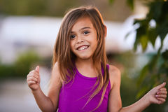 Smiling brown haired four year old girl Stock Images