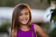 Smiling brown haired four year old girl Stock Photos