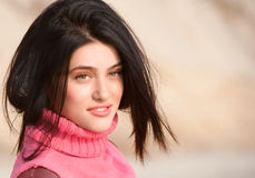 Smiling brunet girl in pink Royalty Free Stock Image