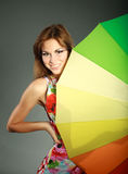 Smiling brunet girl with rainbow umbrella Stock Photos