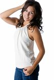 Smiling brunette. Beautiful model with a pretty smile wearing jeans and halter top Royalty Free Stock Photo