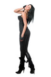 Smiling brunette in black leggings. Isolated Royalty Free Stock Images