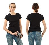 Smiling brunette with blank black shirt Royalty Free Stock Photos