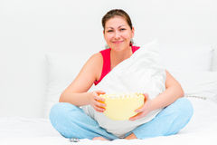 Smiling brunette with a bowl of popcorn Stock Photos