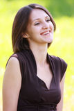 Smiling brunette in brown Royalty Free Stock Photos