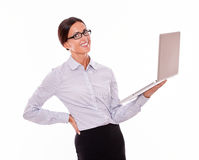Smiling brunette businesswoman with a laptop Stock Photo