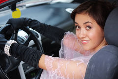 Smiling brunette in car Royalty Free Stock Photo