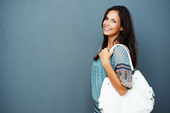 Smiling brunette carrying purse Stock Image